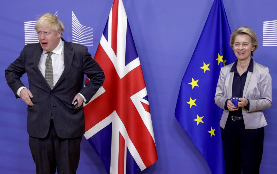 European Commission President Ursula von der Leyen, right, welcomes British Prime Minister Boris Johnson prior to a meeting at EU headquarters in Brussels, Wednesday, Dec. 9, 2020. Leaders of Britain and the EU meet Wednesday for a dinner that could pave the way to a post-Brexit trade deal, or tip the two sides toward a chaotic economic rupture at the end of the month. (Olivier Hoslet, Pool via AP)